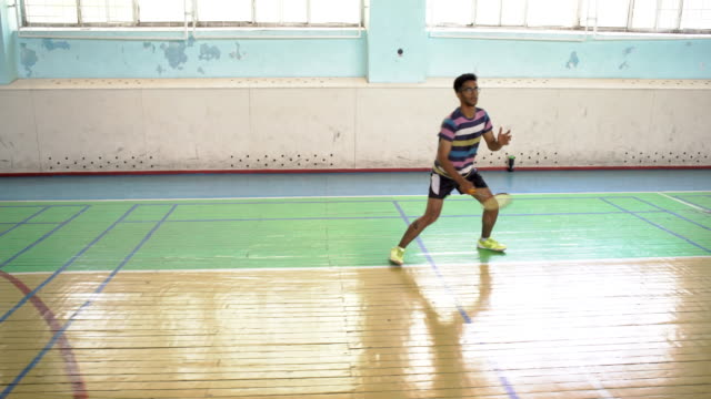 indian guy play badminton in the sports hall - badminton stock videos & royalty-free footage
