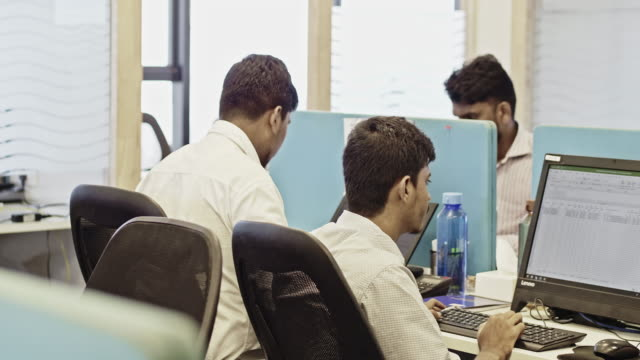 Indian male professionals working at creative office