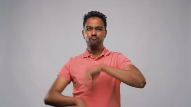 indian man making faces and different gestures