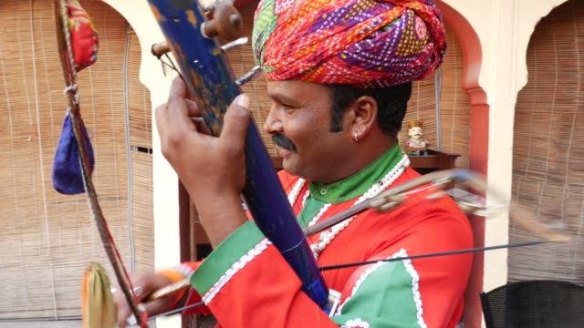 Indian man plays traditional musical instrument in Jaipur, Rajasthan, India video