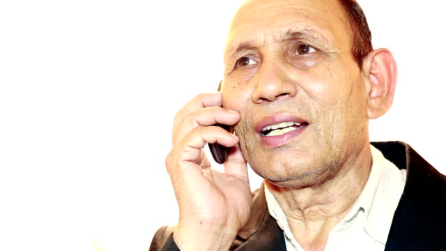 Indian Men Talking on Phone