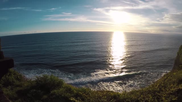 Indian Ocean at sunset, view from the cliff. Uluwatu, Bali, Indonesia Indian Ocean at sunset, view from the cliff. Uluwatu, Bali, Indonesia Slowmo southeast stock videos & royalty-free footage