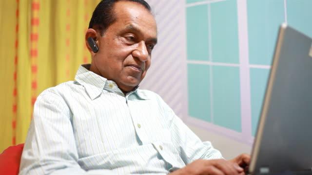 Indian Senior Man Using Laptop having Video Conversation video