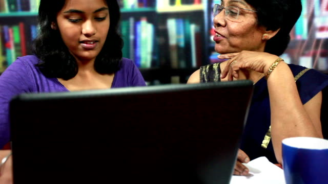 Indian Senior Woman fighting to use laptop with her Granddaughter video