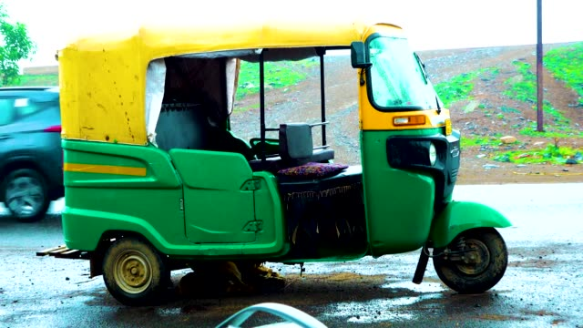 Indian taxi rickshaws exposed in a row.