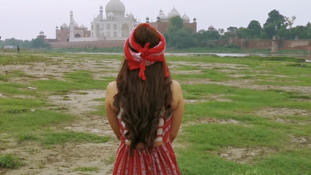Indian woman in red saree/sari in the Taj Mahal, Agra, India