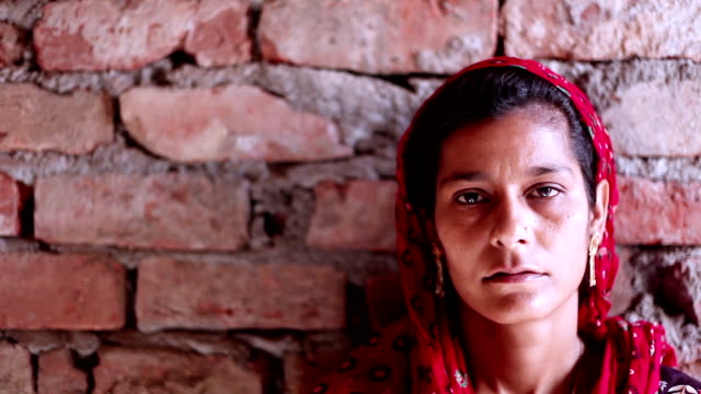 Indian women portrait on brick wall video