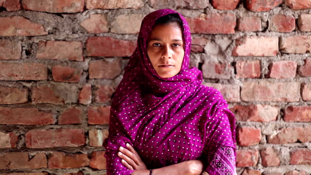 Indian women portrait on brick wall - video