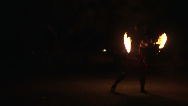 Indigenous Fijian man during during a fire dance video