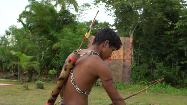 Indigenous man of Tupi Guarani Tribe playing Bow & Arrow, in Brazil video