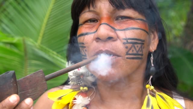 Indigenous Woman Smoking Pipes in Brazil video