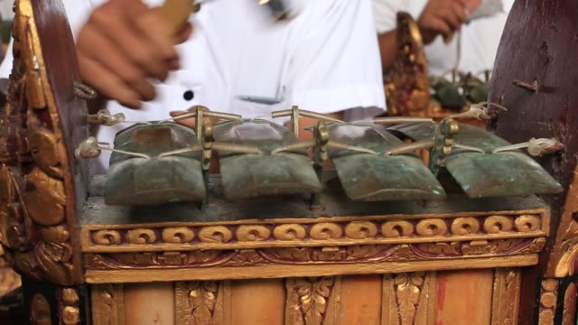 Indonesian children musicians at temple in religious ceremony, Bali, Indonesia
