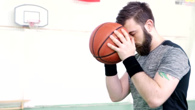 Indoor Basketball Player Holding The Ball video