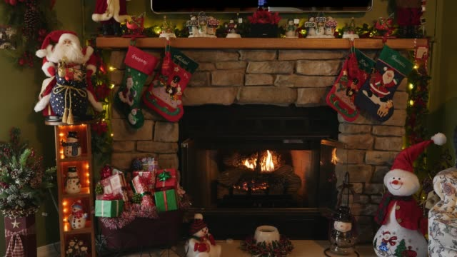 Indoor Christmas Scene with a Fire Place Indoor Christmas Scene with a Mantle and Fire Place Santa Clause and Stockings christmas stocking stock videos & royalty-free footage