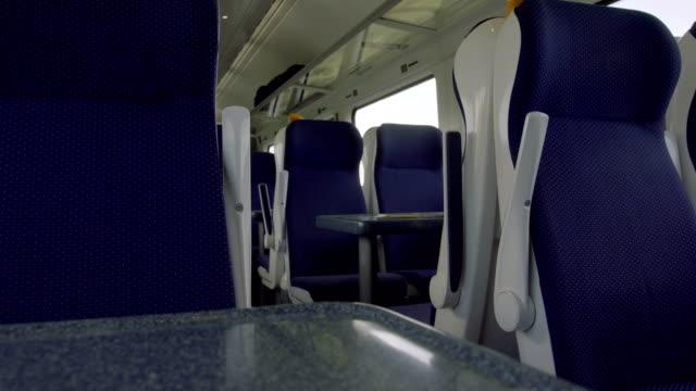 indoor train full with commuter in sunny day 4k - wagon kolejowy filmów i materiałów b-roll