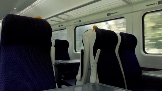 indoor train full with commuter in sunny day - intercity filmów i materiałów b-roll