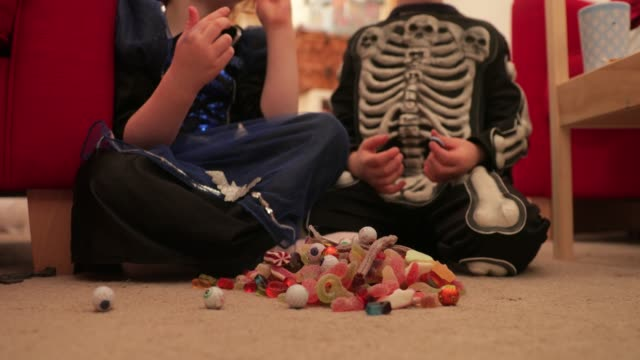 indulging in sweets on halloween - halloween stock videos & royalty-free footage