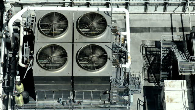 Industrial Air Conditioner Fans on Rooftop of Building video
