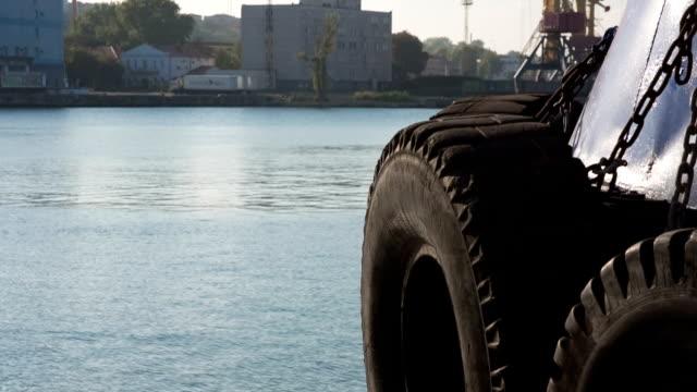 Industrial Backgrounds - Tug Fenders In Port video