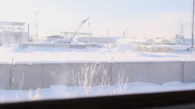Industrial base from the window of a moving train
