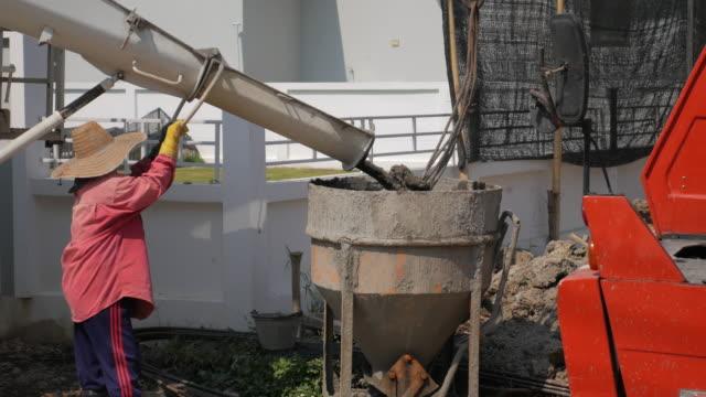 Industrial cement mixer machine at construction site. Concrete pouring , 4k(UHD) video