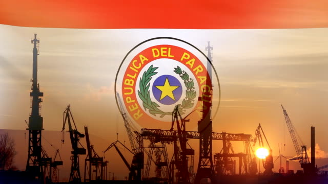 industrial concept with paraguay flag at sunset - парагвай стоковые видео и кадры b-roll