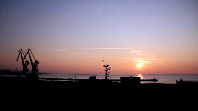 Industrial crane by the sea video