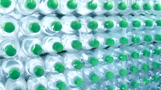 industrial drinks production with countless water bottles - prodotti supermercato video stock e b–roll