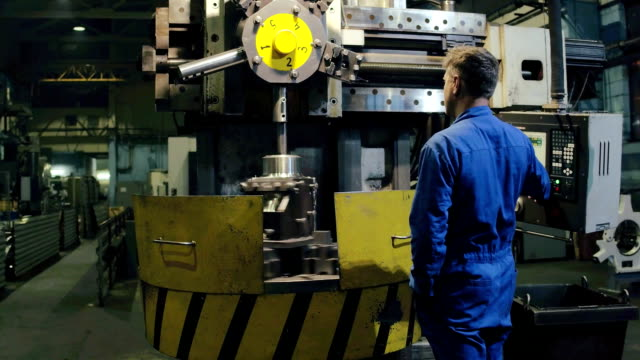 Industrial engineer making test control on modern equipment finished metal parts Industrial engineer making test control on modern equipment finished metal parts after production on metalworking machine at factory in metallurgical industry manufacturing occupation stock videos & royalty-free footage