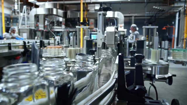 industrial factory indoors and machinery. robotic factory line for processing and bottling of beverage - agricultural machinery stock videos & royalty-free footage