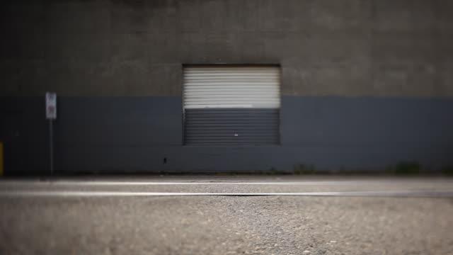 Industrial Garage door. Abstract Alley. no parking sign