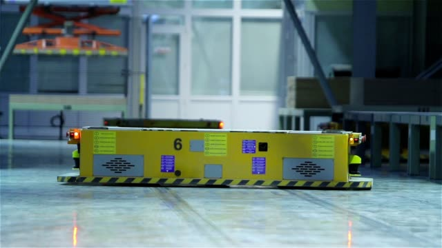 Industrial interior, production of ceramic tiles, modern factory interior, Electrical Automated Guided Vehicles Platform