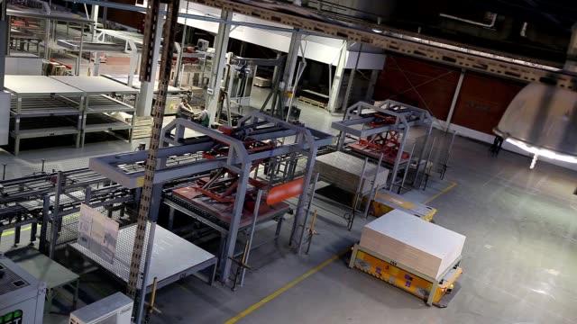 https://media.istockphoto.com/videos/industrial-interior-production-of-ceramic-tiles-modern-factory-video-id874424180?s=640x640