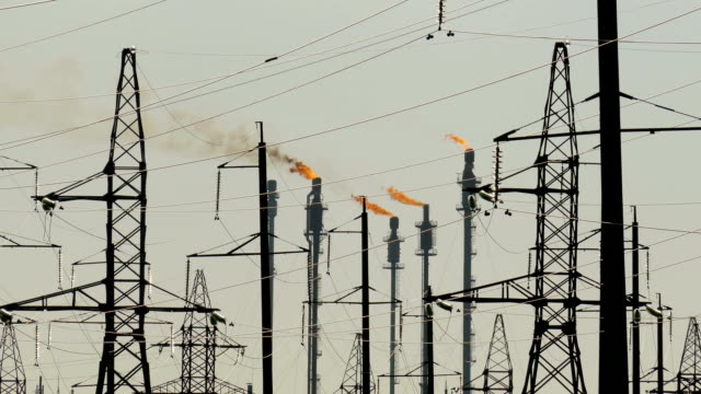 industrial landscape with power lines in the background pipes refinery - sottostazione elettrica video stock e b–roll