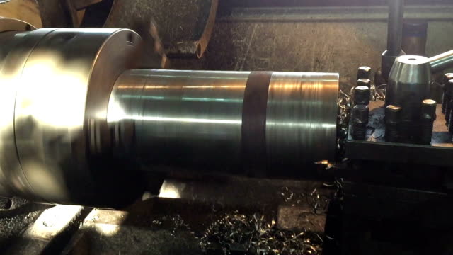 Industrial lathe works metal Industrial lathe works metal production line worker stock videos & royalty-free footage