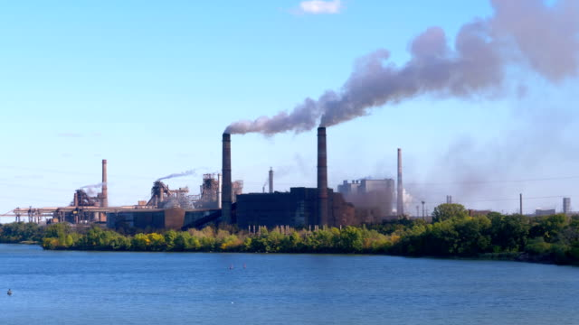 Industrial, Metallurgical Plant in the City Working at Full Power. Smoke from Pipes