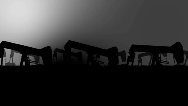 Industrial Oil Pumps Silhouette in an Oil Field in a Polluted Environment video