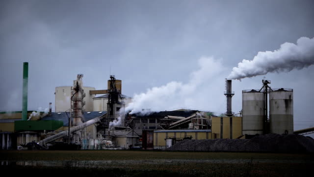 Industrial panorama in France Industrial panorama with smoke and clouds in France. caen stock videos & royalty-free footage