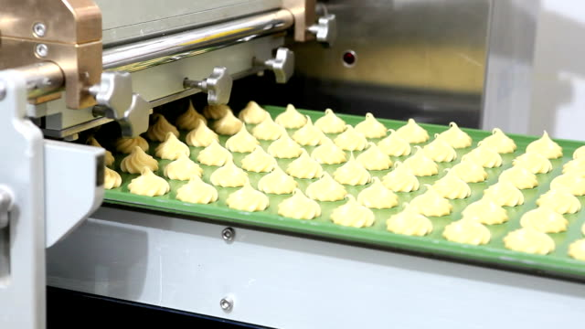 industrial pastry chef prepares the puffs with portioning machine video