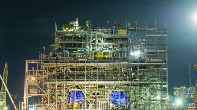 stockvideo's en b-roll-footage met aardolie en raffinaderij fabrieksinstallaties in bouwfase - raffinaderij