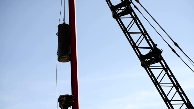 Industrial Pile Driver Industrial Pile Driver piling a column into the ground crane construction machinery stock videos & royalty-free footage
