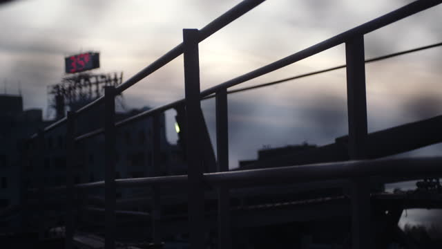 Industrial railing against the sunset