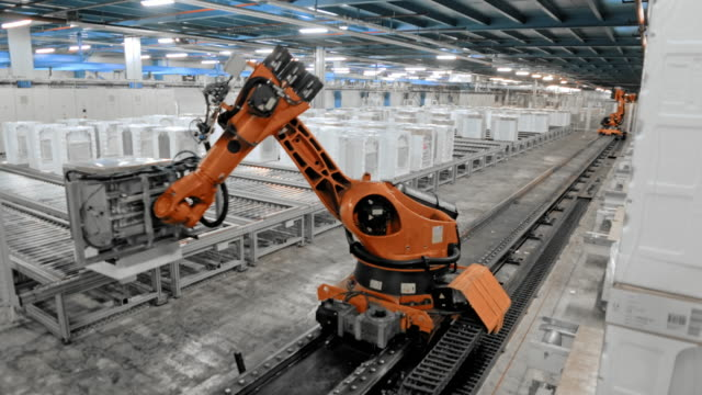 TIME-LAPSE Industrial robot moving up the production hall and sorting the products