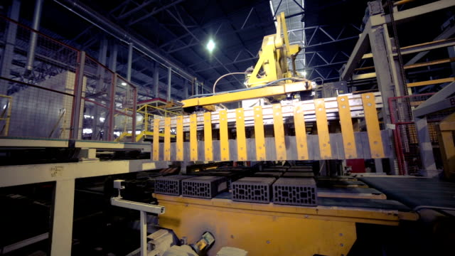 Industrial robot. Robotic arm assembling products on a modern plant Industrial robot. Robotic arm assembling products on a modern plant. HD. car transporter stock videos & royalty-free footage