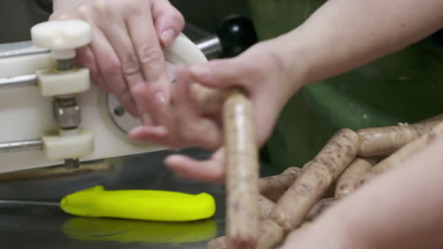 Industrial sausages production process at meat and sausage making plant video