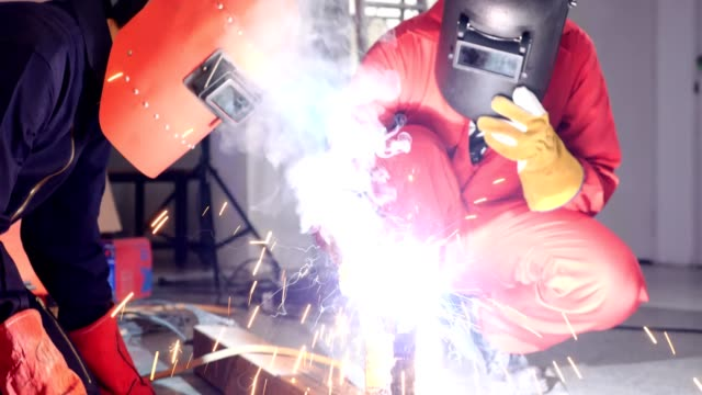 Industrial technicians are working hard in the factory. video