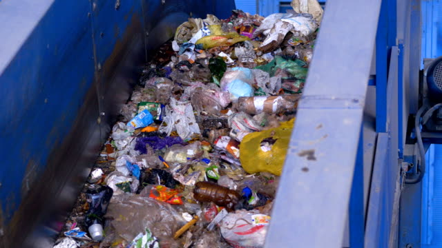 Industrial trash conveyor system. Garbage moving on conveyor. Recycling factory indoor. video