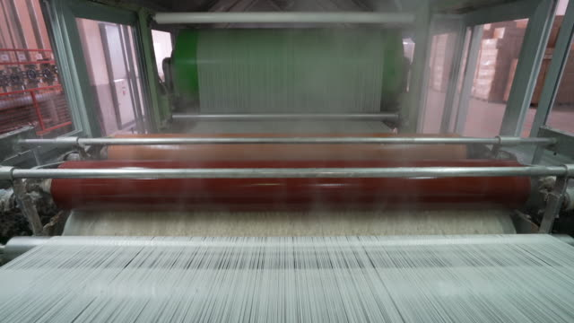 Industrial warping and sizing machine in textile factory