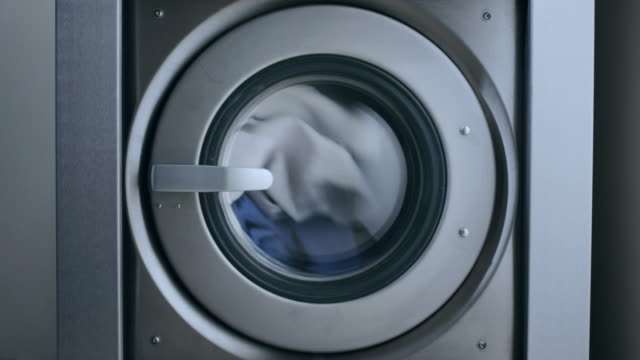 Industrial washer machine. Clothes laundry machine. Washing clothes laundry Industrial washer machine working. Clothes laundry machine. Close up of laundry clothes in industry washing machine. Working washing machine. Closeup of clothes washer. Laundry clothes washing appliance stock videos & royalty-free footage