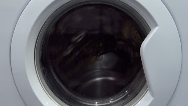 industrial washer machine working. close up of laundry clothes in industry washing machine. - pranie filmów i materiałów b-roll